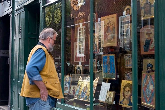 man looking in window of Cornelissens