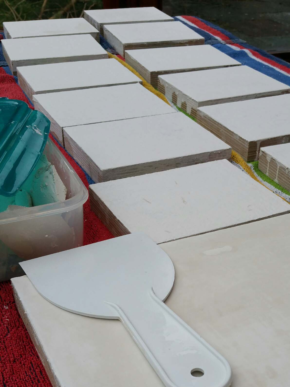 icon boards laid out to gesso