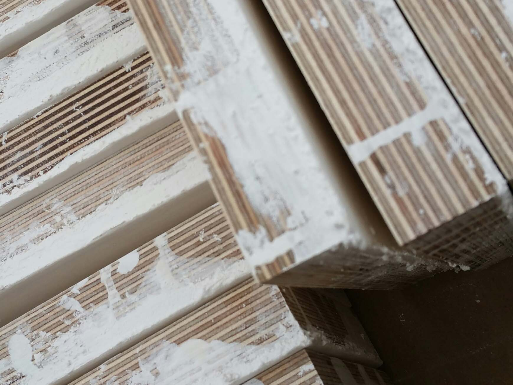 Splashes of gesso on sides of boards